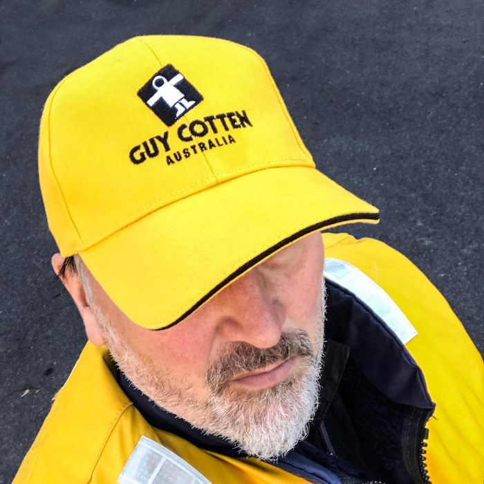 Guy Cotten Cap Yellow on Man